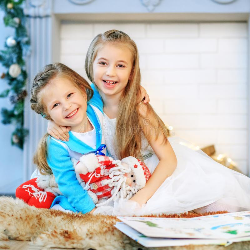 Children hugging and happy. Concept New Year, Merry Christmas, h. Oliday, vacation, winter childhood stock images