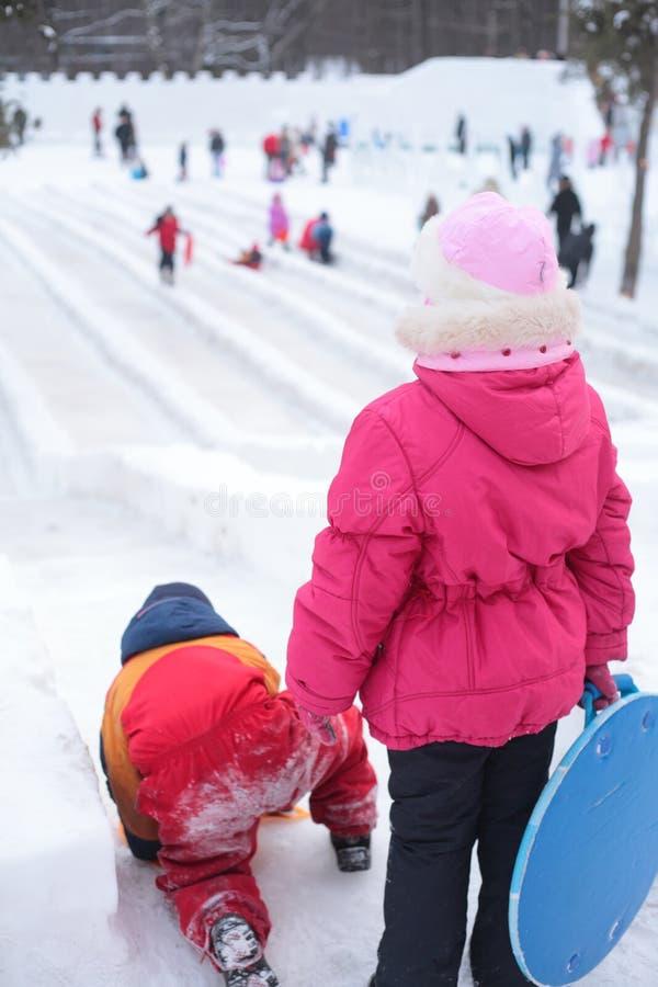 Children on ice slope in park