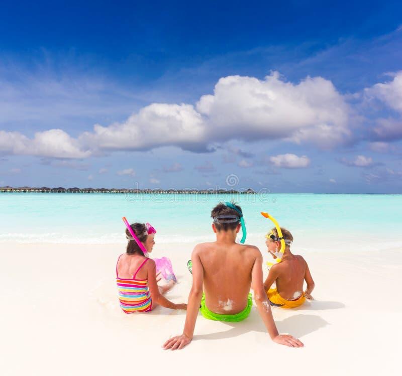 Children on idyllic beach royalty free stock photos