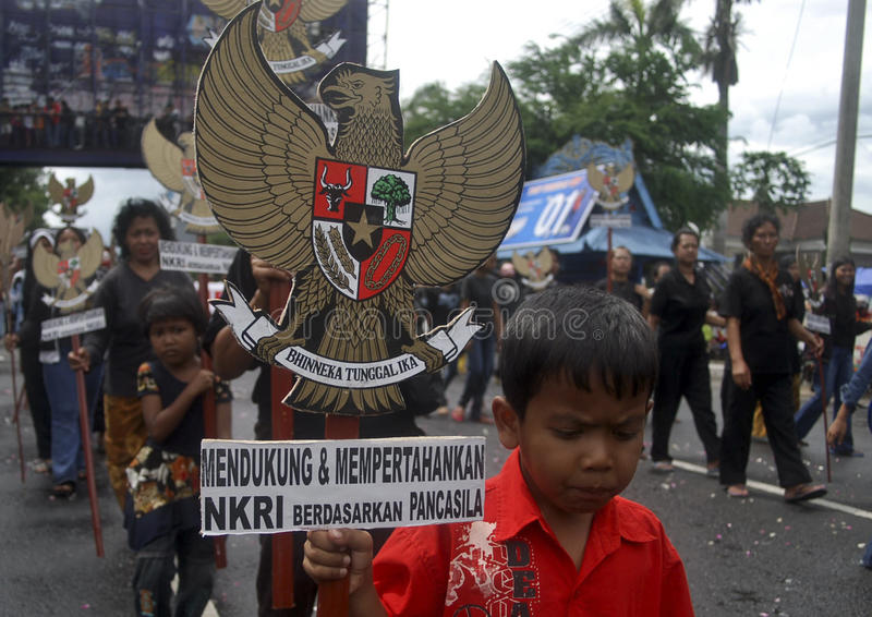 CHILDREN OF INDONESIA POPULATION. A boy is attending political rally on the street of Solo, Java, Indonesia. Of the 237 million inhabitants, almost one-third are royalty free stock photography