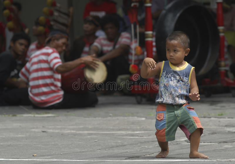 CHILDREN OF INDONESIA POPULATION. A child Reog Dancer of Solo, Java, Indonesia. Of the 237 million inhabitants, almost one-third are under the age of 18, and as stock photography