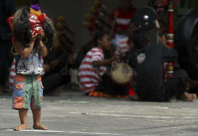 CHILDREN OF INDONESIA POPULATION. A child Reog Dancer of Solo, Java, Indonesia. Of the 237 million inhabitants, almost one-third are under the age of 18, and as royalty free stock photos
