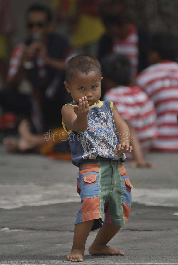 CHILDREN OF INDONESIA POPULATION. A child Reog Dancer of Solo, Java, Indonesia. Of the 237 million inhabitants, almost one-third are under the age of 18, and as stock photos