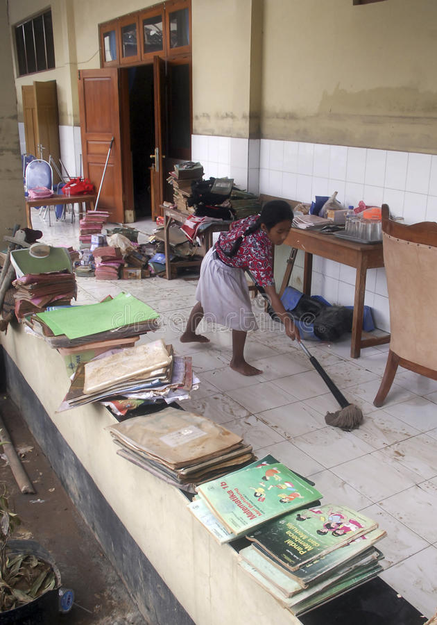 CHILDREN OF INDONESIA POPULATION. A children cleans school class room in Solo, Java, Indonesia. Of the 237 million inhabitants, almost one-third are under the stock photography