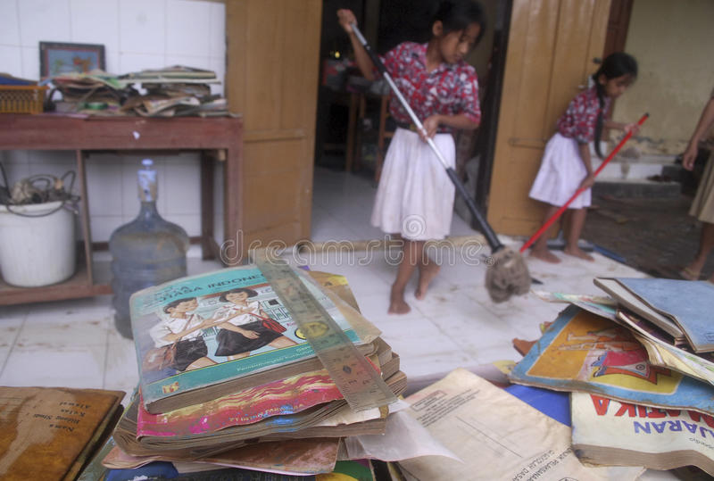 CHILDREN OF INDONESIA POPULATION. A children cleans school class room in Solo, Java, Indonesia. Of the 237 million inhabitants, almost one-third are under the royalty free stock photos