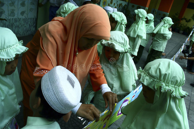 CHILDREN OF INDONESIA POPULATION. School children attend nutrition class at their school in Solo, Java, Indonesia. Of the 237 million inhabitants, almost one royalty free stock photography