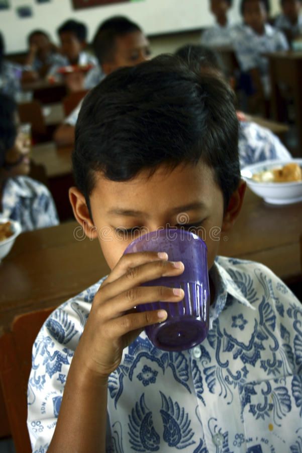 CHILDREN OF INDONESIA POPULATION. School children attend nutrition class at their school in Solo, Java, Indonesia. Of the 237 million inhabitants, almost one royalty free stock photo