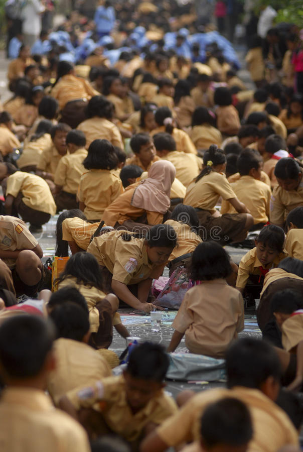 CHILDREN OF INDONESIA POPULATION. School children attend outdoor class at their school in Solo, Java, Indonesia. Of the 237 million inhabitants, almost one-third royalty free stock photo