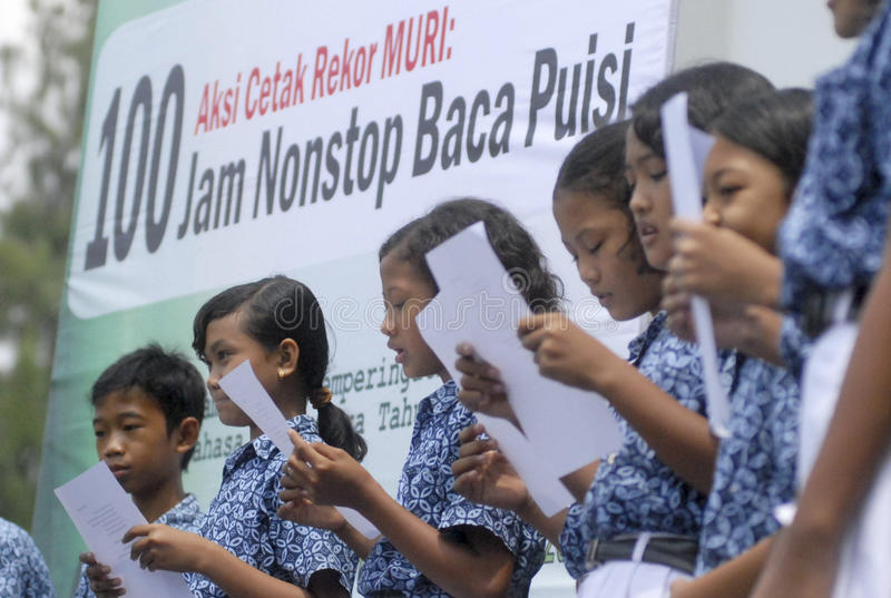 CHILDREN OF INDONESIA POPULATION. School children attend outdoor class at their school in Solo, Java, Indonesia. Of the 237 million inhabitants, almost one-third stock photography