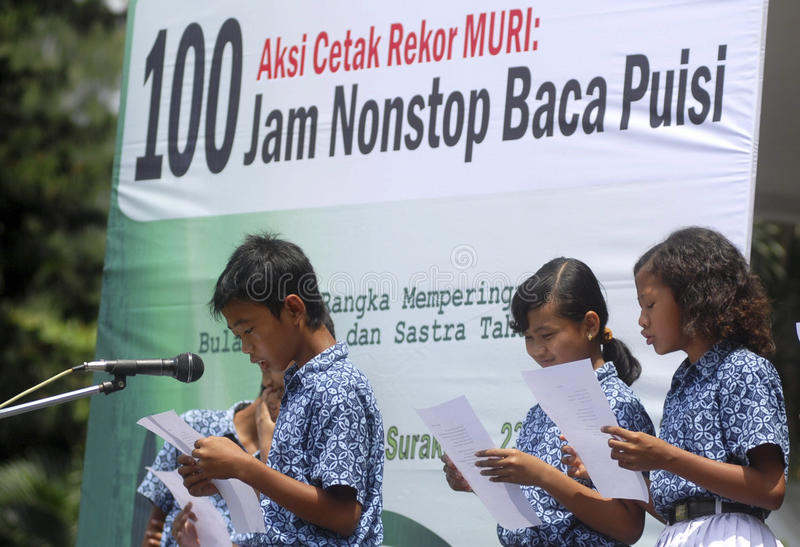 CHILDREN OF INDONESIA POPULATION. School children attend outdoor class at their school in Solo, Java, Indonesia. Of the 237 million inhabitants, almost one-third stock image