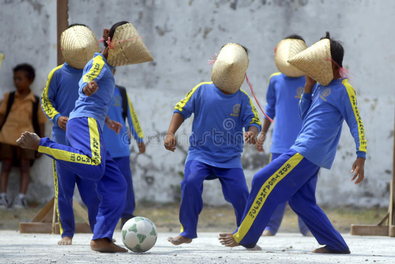 CHILDREN OF INDONESIA POPULATION. School children play at their school in Solo, Java, Indonesia. Of the 237 million inhabitants, almost one-third are under the royalty free stock photography