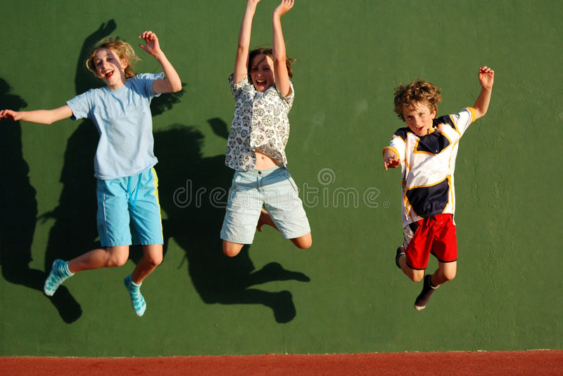 Children jumping. Group shot of 3 children jumping, nikon D70 stock image