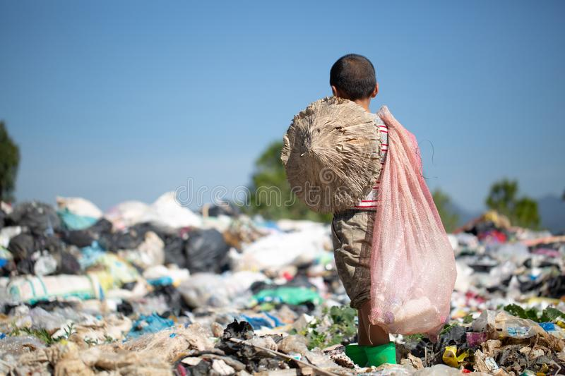 Children are junk to keep going to sell because of poverty, ,World Environment Day, Poverty concept.  stock photo