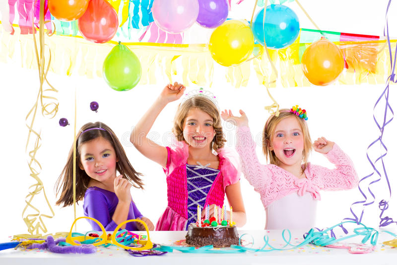 Children kid in birthday party dancing happy laughing. With baloons serpentine and garlands royalty free stock image