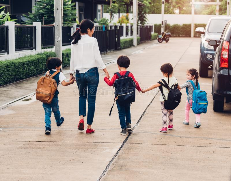 Children kid son girl and boy kindergarten walking going to school stock image