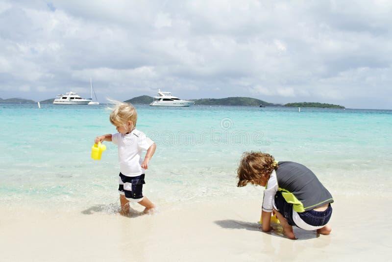 Children, kids having Fun on Tropical Beach near Ocean. Children, kids having fun on a white sand tropical beach near Caribbean ocean royalty free stock image