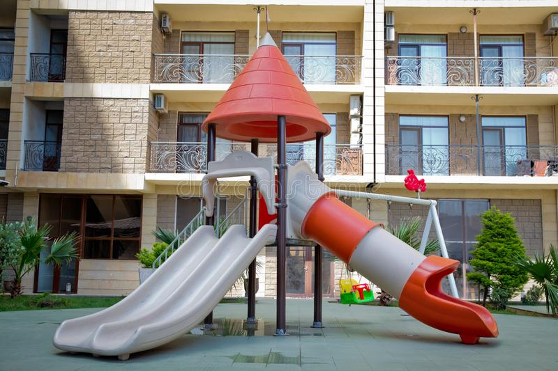 Children kids playground with play equipment outdoor. Kids playground with slides in the park. play ground red and white big royalty free stock image