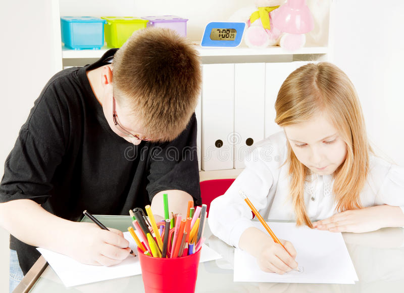 Children in kindergarten painting drawings royalty free stock photo