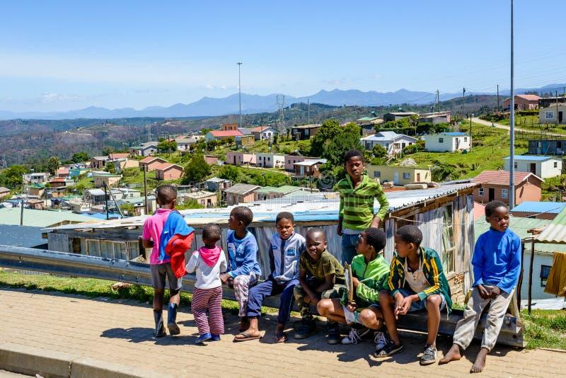 Children in a Knysna township near Mandela houses stock photo