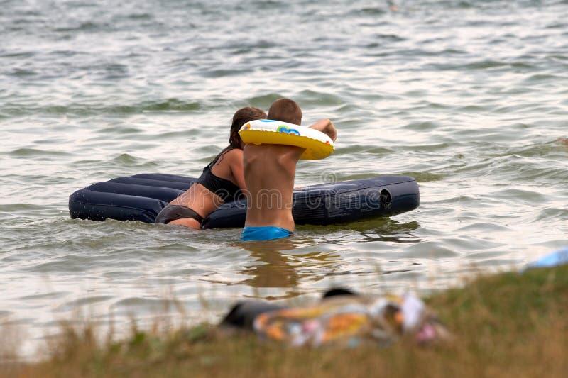 Children on lake stock photos