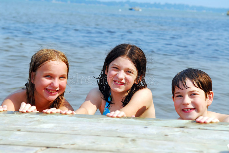 Children in a lake stock photos
