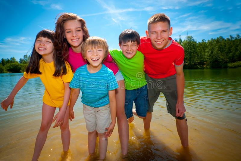 Children in lake stock photography
