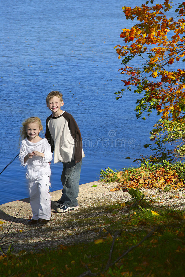 Children By Lake In Park Stock Photo