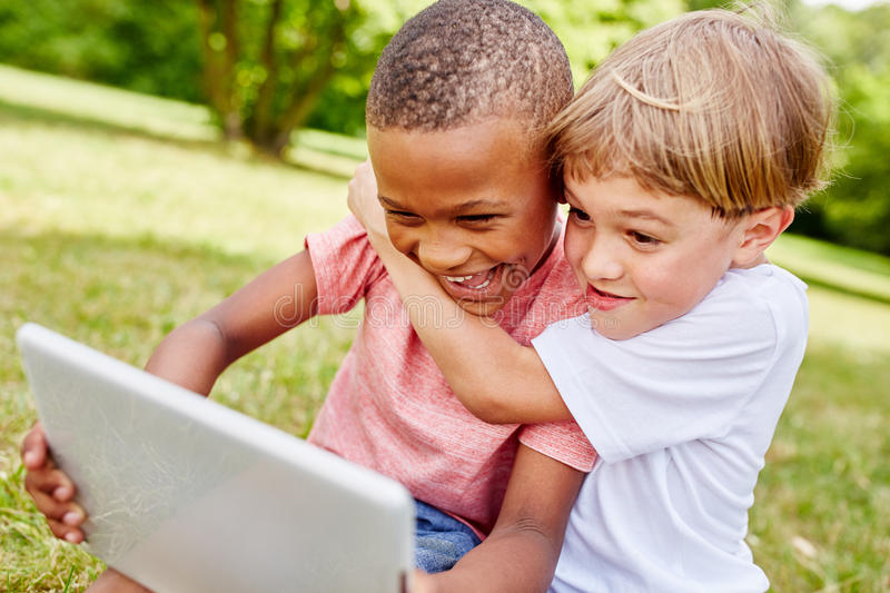 Children with laptop having fun. And learning in summer royalty free stock photo