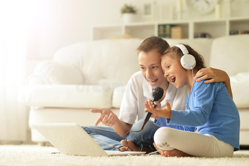 Children with laptop at home. Portrait of a happy children with laptop at home royalty free stock images