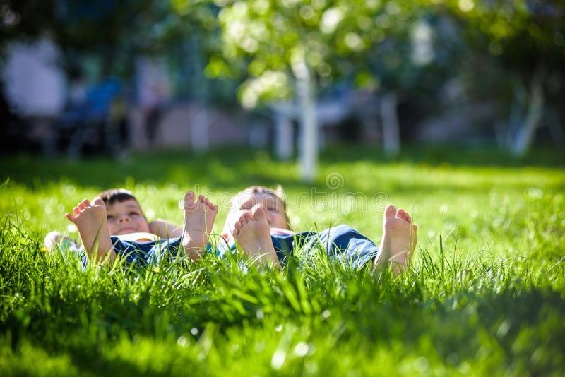 Children laying on grass. Family picnic in spring park stock photography