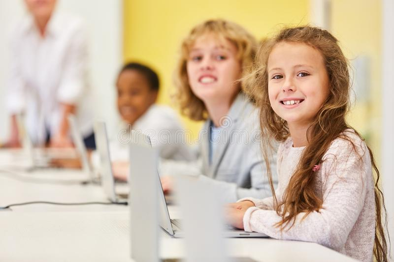 Children learn media literacy and computer science. At the elementary school computer royalty free stock photography