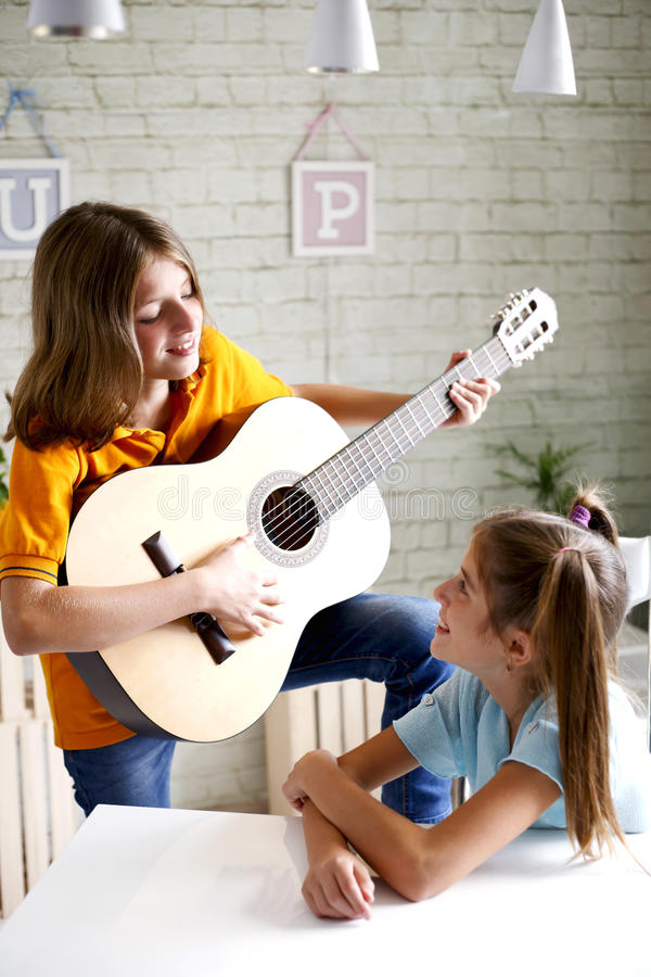 Children learn to play guitar. Student-child-guitar-music stock image