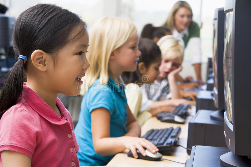 Children learning how to use computers.
