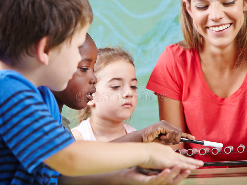 Children learning instruments. In music school in musical education class stock images