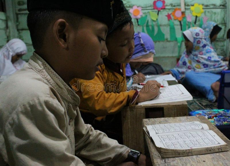 Children are learning to read al quran in the TPA royalty free stock image