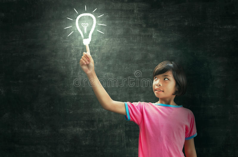 Children lighting and blackboard royalty free stock photos