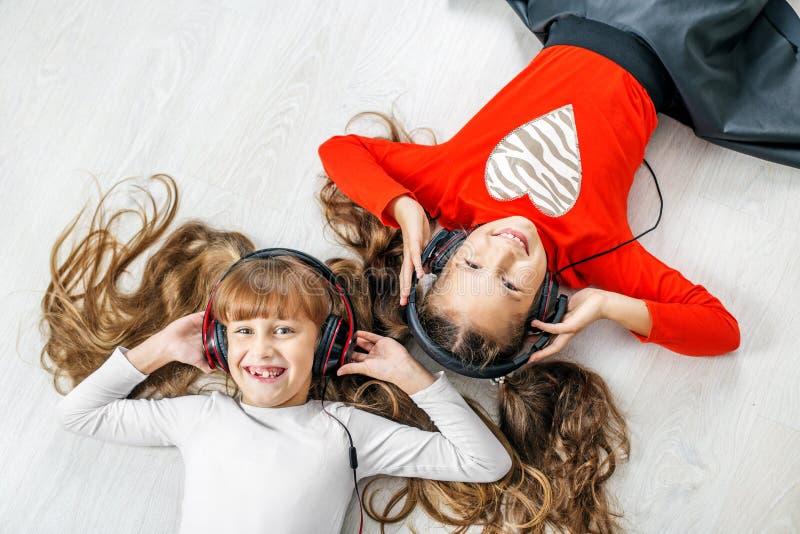 Children listen to music on headphones. Concept music, radio, da. Nce, life stroke, rest royalty free stock images