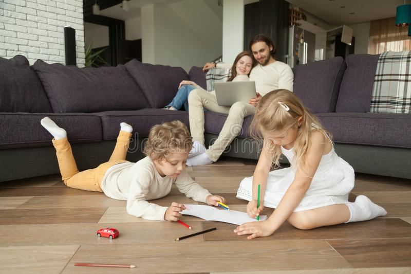 Children little boy and girl having fun on warm floor stock photography