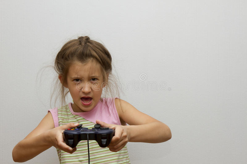 Children little girl holding joystick happy play video game stock image