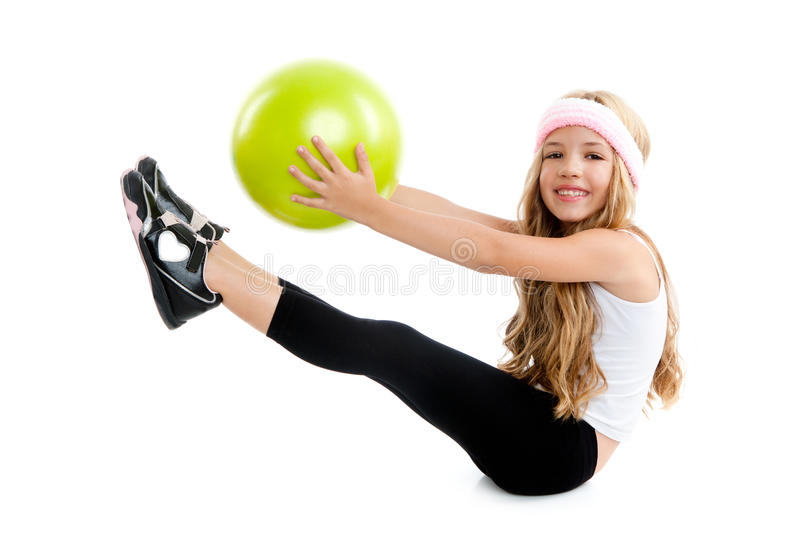 Children little gym girl with green yoga ball stock images