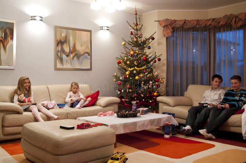 Children in living room stock photos