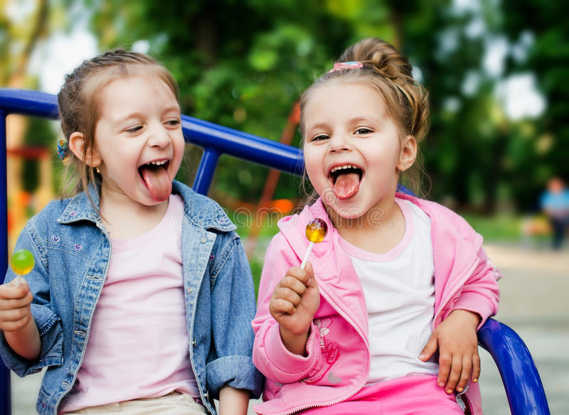 Children with lollipops stock photography