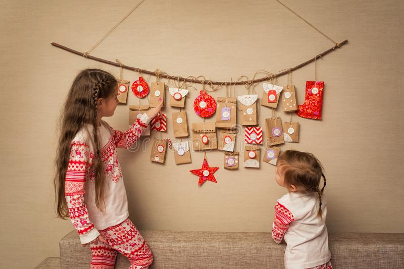 Children look at advent calendar. option DIY to wait for Christmas for kids.  royalty free stock photo