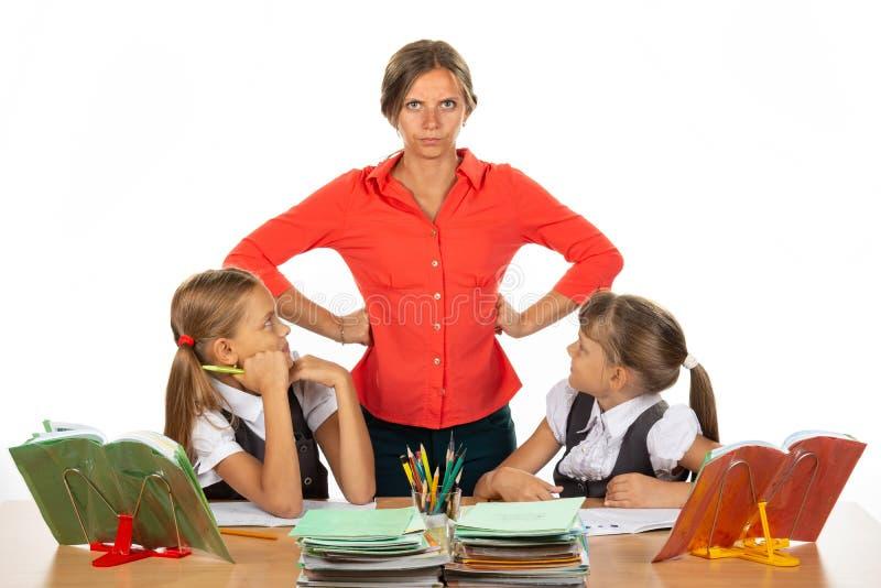 Children look at an evil teacher royalty free stock photos