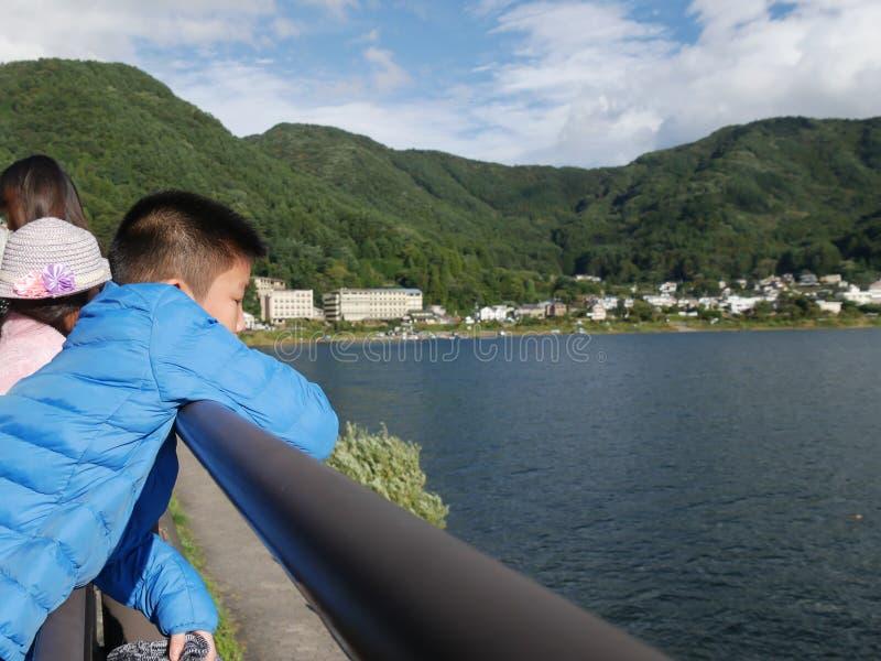 Children looking at Kawaguchigo lake. Happy Children looking at Kawaguchigo lake, Japan stock images