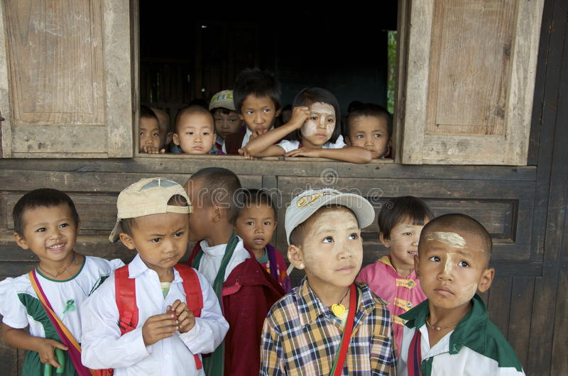 Children looking out the window of school stock image