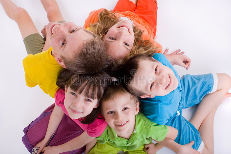 Children looking up. Five caucasian happy smiling kids sitting in a circle on the floor and looking up stock image