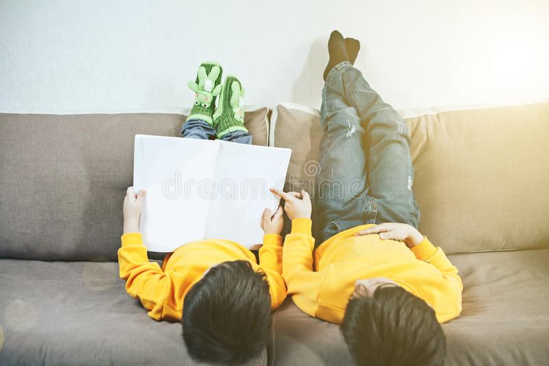 Children are lying on the couch royalty free stock images