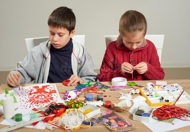 Children make crafts and toys, handmade concept. Artwork workplace with creative accessories. stock images