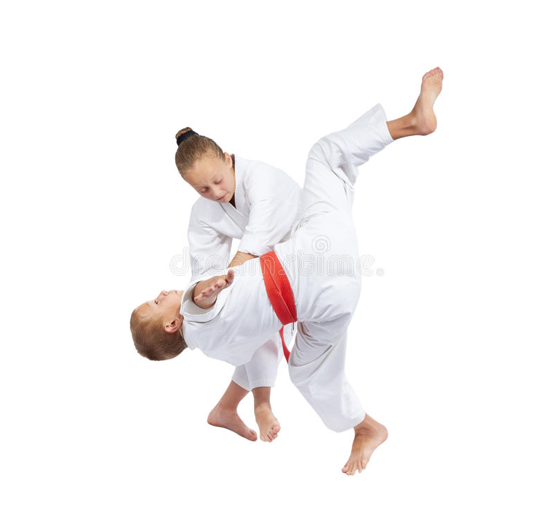Children make the throws of judo in judogi stock image